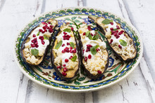 Filled Aubergines With Couscous, Yogurt Sauce, Mint And Pomegranate Seeds