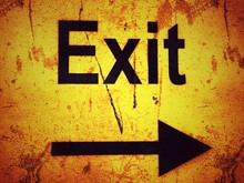 Exit Sign On A Yellow Grunge B...