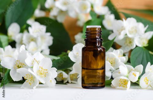 Fototapeta Small bottle of essential jasmine oil