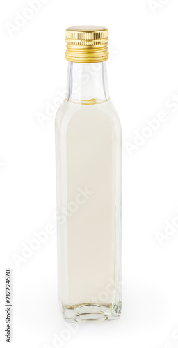 White vinegar in glass bottle isolated on white background with clipping path