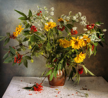 A Bouquet With Flowers And Eld...