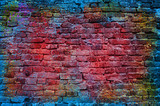 Fototapeta Młodzieżowe - Paint splash, graffiti brick wall, colorful background