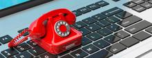 Red Vintage Telephone On Compu...