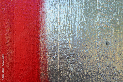 graffiti texture on wooden material in silver red. backdrop © lcrms