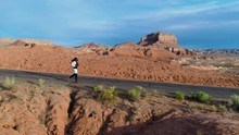 Man Jogging On Desert Road