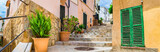 Fototapeta  - Beautiful alley staircase at the old mediterranean town of Andratx on Mallorca, Spain