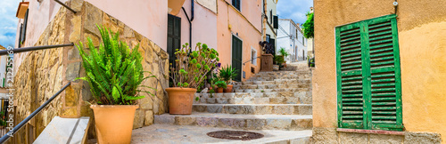 Beautiful alley staircase at the old mediterranean town of Andratx on Mallorca, Spain