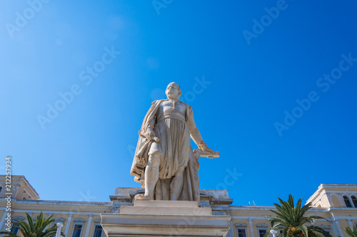 Fotografie, Obraz  Andreas Miaoulis statue in front of the city Hall of Syros island in Cyclades, G