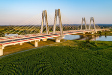 New Modern Double Cable-stayed Bridge Over Vistula River In Krakow, Poland. Part Of The Ring Motorway Around Krakow Under Construction. Aerial View At Sunset