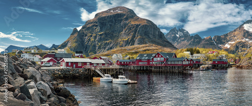 Poster Cote Panoramic shot of A village, Moskenes, on the Lofoten in northern Norway. Norwegian fishing village, with the typical rorbu houses. Mountain In Background