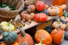 Farmers Market Goods Display. Colorful Gourds And Honey Jars For Sale At Autumn Seasonal Farmers Market. Agriculture, Farming And Small Business Background. Harvest Concept.