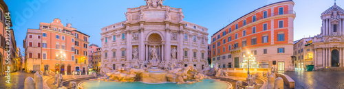 Poster Rome Trevi Fountain illuminated at night in the heart of Roma