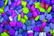 Leinwanddruck Bild - Colourful sugar candy flowers background, copy space. Closeup of pile blue, green and violet chocolate candies. Candy texture. Candy pattern. Sweets background. Top view, flat lay