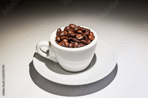 Foto op Canvas Cafe coffee cup full of roasted coffee beans