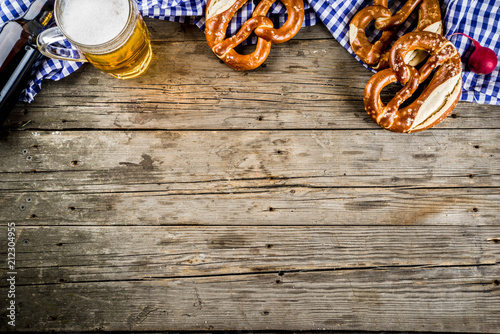Oktoberfest food menu, bavarian pretzels with beer bottle mug on old rustic wood Fototapet
