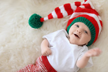 Adorable Baby In Christmas Hat On Fuzzy Rug