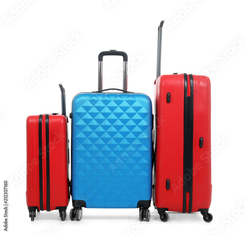 Fototapety, obrazy: New suitcases packed for journey on white background