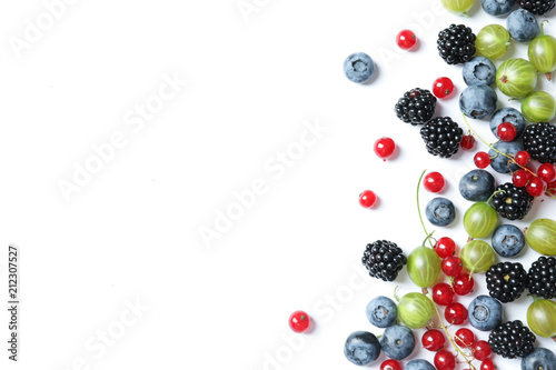 Mix of different fresh berries on white background - 212307527