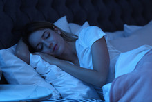 Young Woman Sleeping In Bed At Night. Sleeping Time