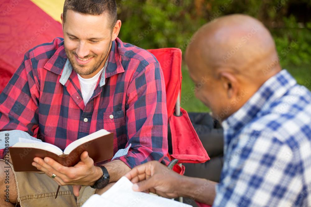 Fototapety, obrazy: Men having a bible study.