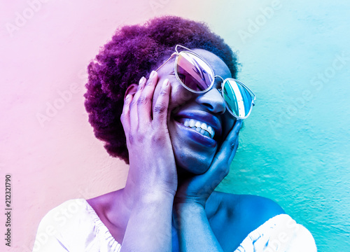 Fotografie, Obraz  Millennial african woman smiling and wearing sunglasses
