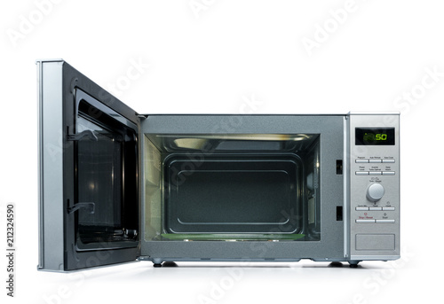 Microwave oven with door open, isolated on white background.