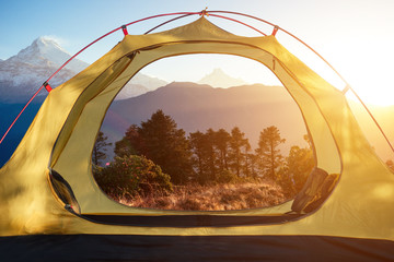 standing tent with a beautiful view of the mountains with autumn trees