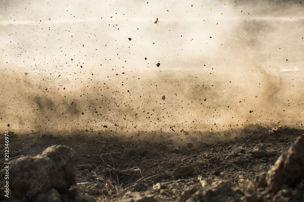 Fototapeta dirt fly after motocross roaring by