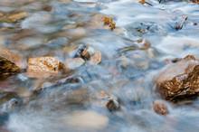 Crystal Clean Little Creek Long Exposure Shot, Focus On The Orange Rocks.