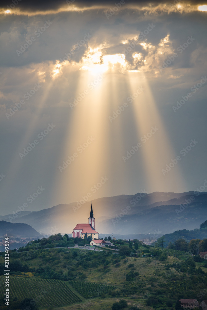 Fototapety, obrazy: Sun rays shining down on a Church