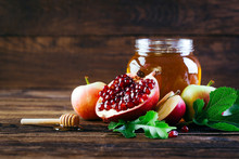 Jewish Holiday Rosh Hashanah, Apples Honey And Pomegranate On The Wooden Table, Copy Space