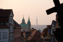 Сity Under The Holy Cross. View Of The Streets Of Prague (Nerudova Street) And The Church Of Saint Nicholas At Dawn, Prague, Czech Republic