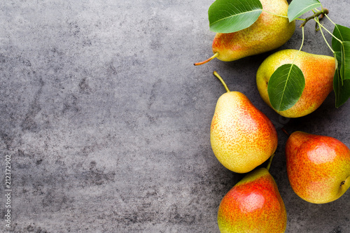 Fresh bio pear with leaves on the plate. Gray stone table. Wallpaper Mural