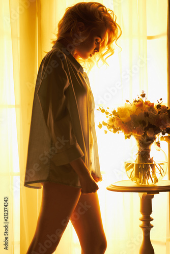 Deurstickers womenART Sensual blonde at the window