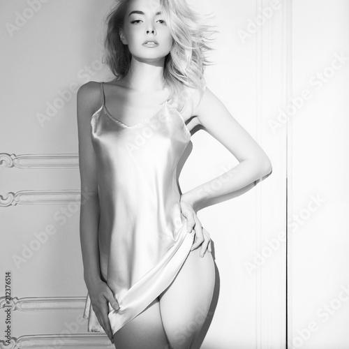 Deurstickers womenART Sensual blonde in white interior