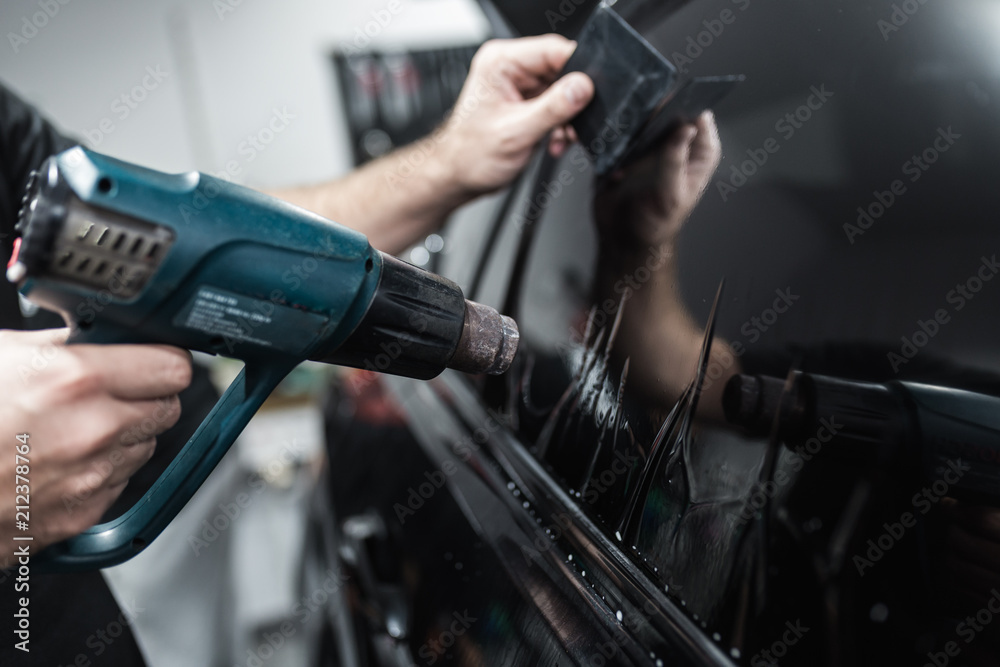 Fototapety, obrazy: Car tinting - Worker applying tinting foil on car window.