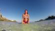 slow motion: beautiful happy girl splashing water at summer sea beach