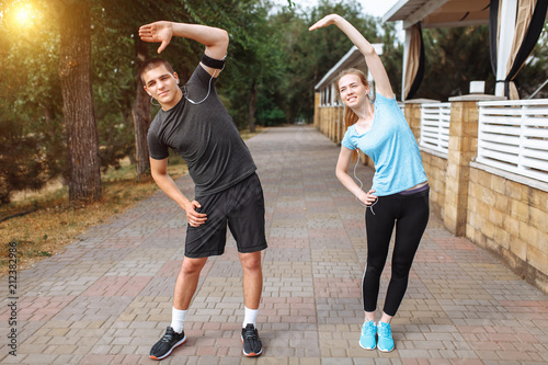 morning exercises for men and women, training before work, two people athletes Poster
