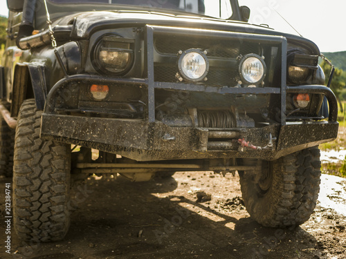 Foto op Plexiglas Havana close up dirty bumper off road 4x4 truck car on the dirty ground