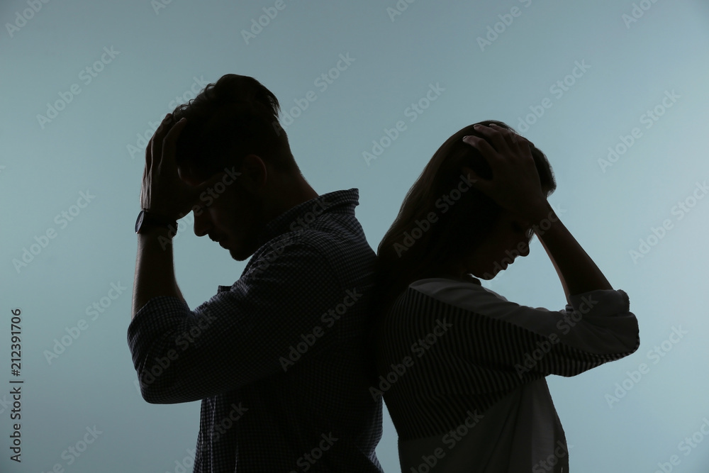 Fototapety, obrazy: Silhouette of upset couple on color background. Relationship problems