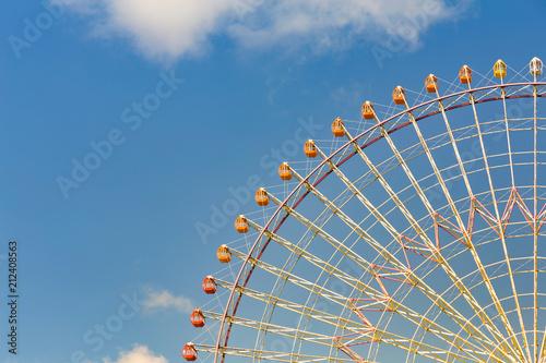 Poster Stad gebouw Tokyo giant ferris wheel against blue sky background