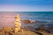 Stacked stone with sea coast skyline abstract background