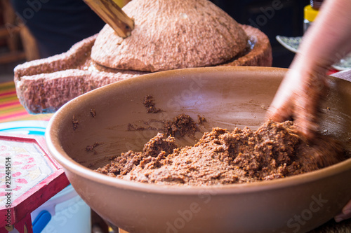The process of pressing oil from argan seeds. Obtaining oil