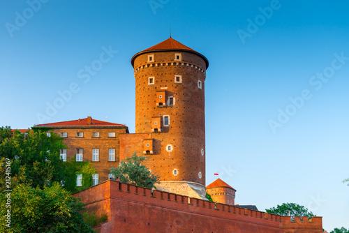 Fototapeta Krakow, Poland - August 11, 2017: high brick tower - Wawel castle in the suumer day against the blue sky obraz