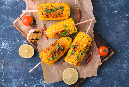 Grilled corn cobs  with garlic and pepper