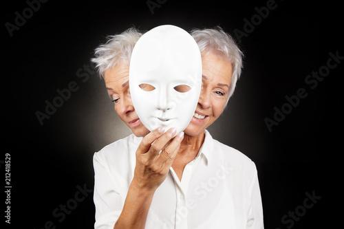 older woman hiding happy and sad face behind mask, concept for manic depression Tapéta, Fotótapéta