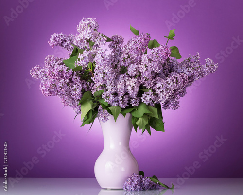 Keuken foto achterwand Bloemen Lush bouquet of flowers in vase on lilac background