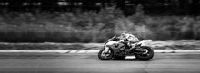 Motorcycle Racer On Highway An...