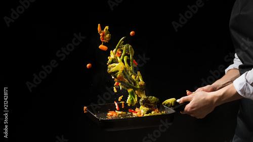 Fototapeta The chef prepares. Black background for copy text.Concept cooking obraz