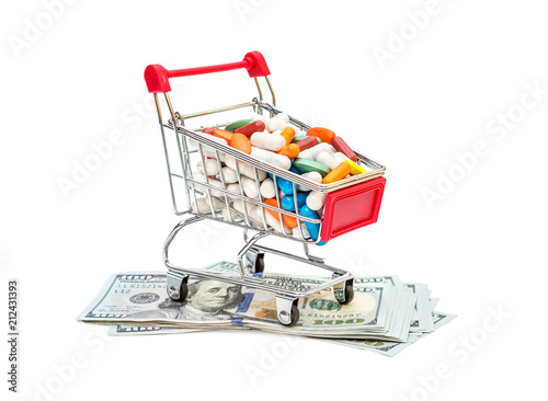 Poster Full shopping cart with pills on dollar bills on white background.